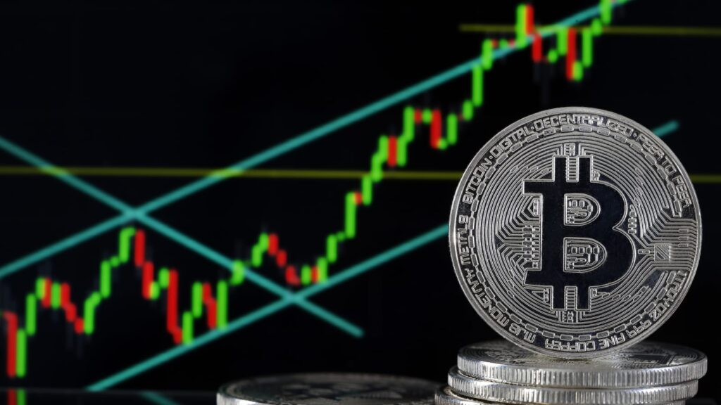 bitcoin chip with stock chart rising behind it